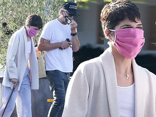 Selma Blair dons a chic look in striped pants and a white blazer as she grabs lunch with her beau