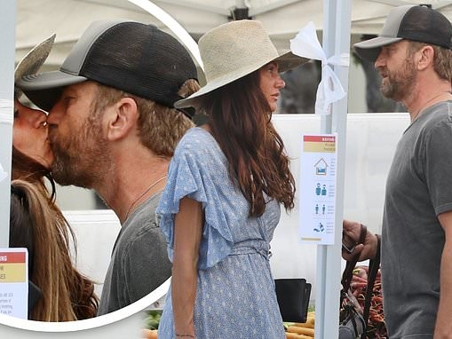 Gerard Butler plants a kiss on his girlfriend Morgan Brown while shopping in Los Angeles