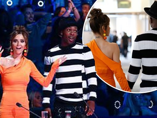 Cheryl flaunts her sensational curves in figure-hugging orange bodycon dress on The Greatest Dancer