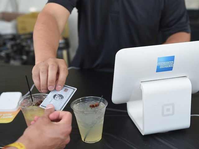 American Express is paying some merchants up to $450,000 to start accepting its cards. Here's what small business owners should know about the sign-up bonus.