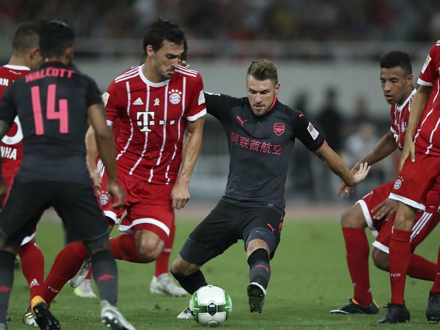Arsenal sick of Bayern Munich, but scrape win in Shanghai