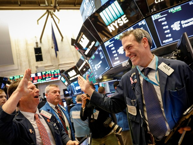 The Dow jumps as many as 400 points