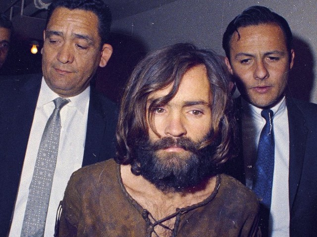 Charles Manson was sentenced to 9 life sentences for orchestrating 7 gruesome murders with his cult 'family' — here's his life story