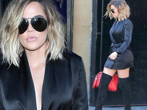 Khloe Kardashian stuns in silk blazer and thigh-high boots