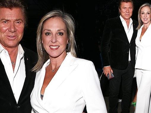 Richard Wilkins' girlfriendVirginia Burmeister stuns in white suit at Sydney's Fashion Week