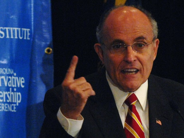 Rudy Giuliani says he was just 'tucking in my shirt' after being filmed by Sacha Baron Cohen with what appears to be his hand in his pants in front of a female actor