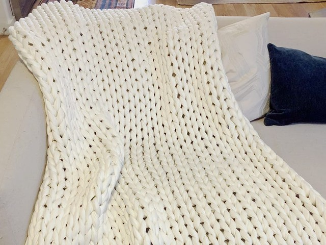 This weighted blanket has a woven texture that prevents me from overheating at night — it also helps me sleep deeper and faster