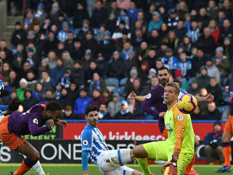 Man City ease past Huddersfield to cut Liverpool's lead
