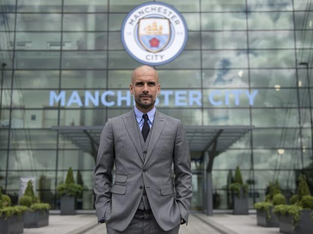Pep Guardiola extends Man City contract until 2023