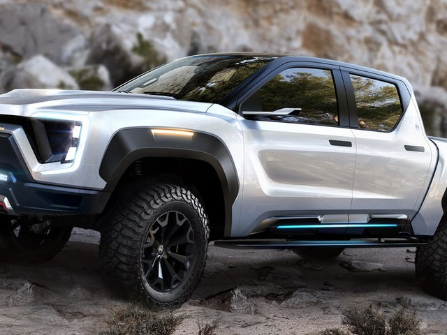 A new electric pickup truck with a longer range than Tesla's Cybertruck will beat the hotly anticipated EV to market — check out the Badger