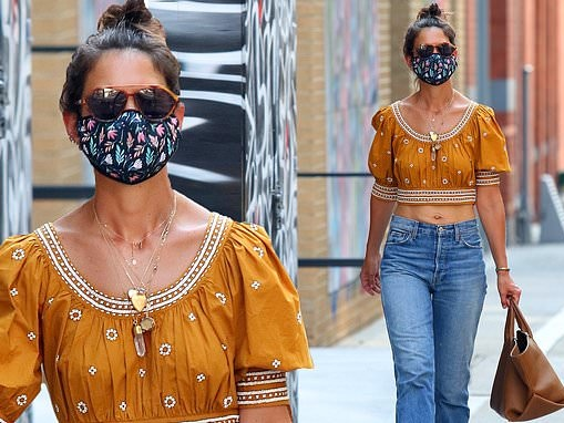Katie Holmes flaunts her toned midsection in a cropped blouse as she enjoys a solo shopping trip