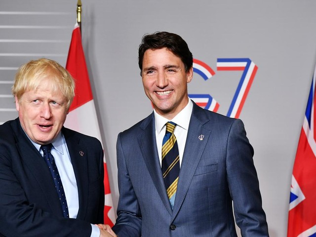 UK and Canada agree post-Brexit trade can continue under same terms as EU deal