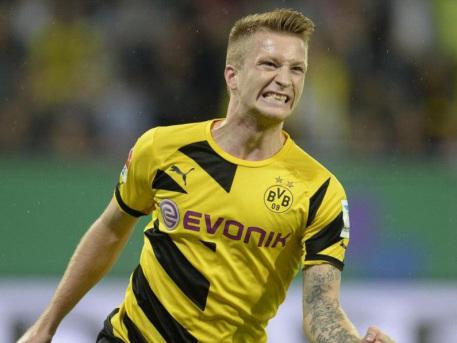Dortmund resist urge to rush Reus back at Real