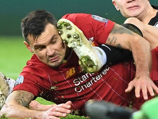 Dejan Lovren forced off with knee injury in Liverpool's clash with RB Salzburg