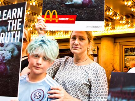 Edie Falco & Son Anderson Protest McDonald's in Times Square