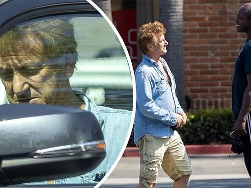 Sean Penn chats with a friend while shopping in Malibu