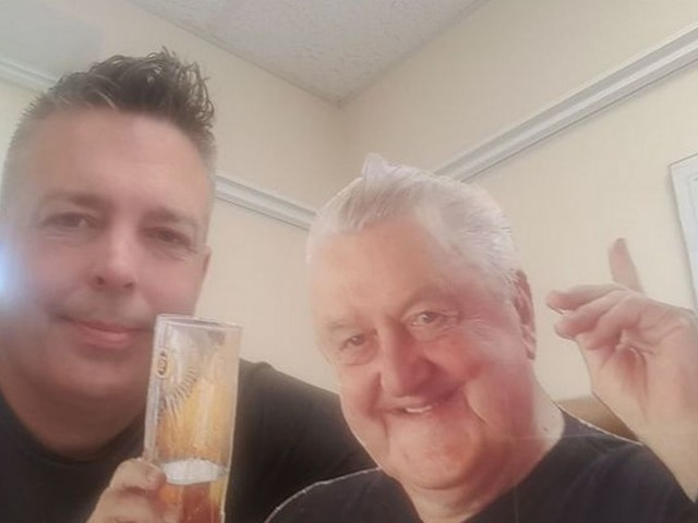 Grandad appears at own wake as cardboard cutout with pint of beer