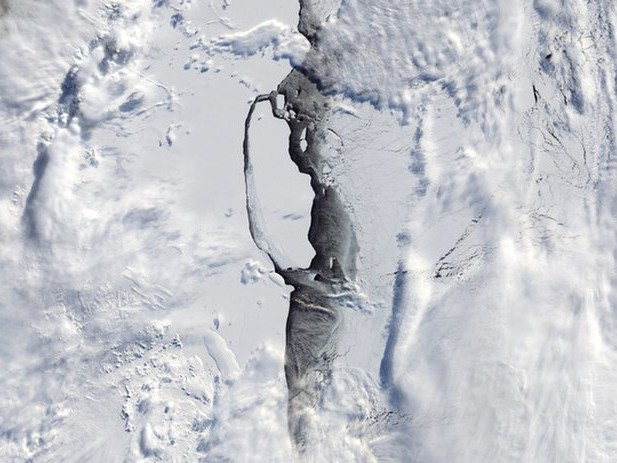 Massive Calved Iceberg Comes into View as Antarctic Sun Rises