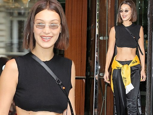 Bella Hadid wears a tiny crop top as she steps out in Paris