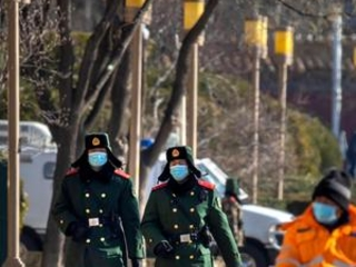 The Latest: China says COVID shots will be free in country