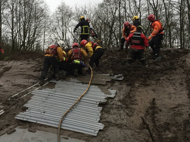 Two school boys had to be rescued after they got stuck playing in mud in Bury and started to sink