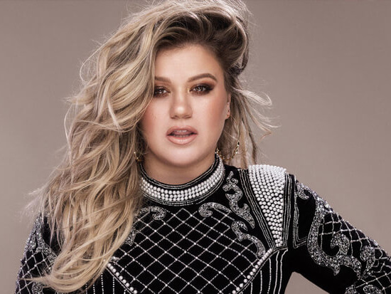 "Kelly Clarkson Uncovers The ""Meaning Of Life"" On New Buzz Track"
