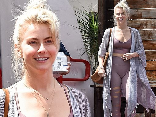 Julianne Houghshows off dance-honed figure in blush leggings and sports bra following a workout