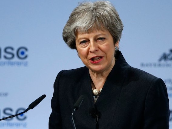 Theresa May announces plan to slash tuition fees as experts warn policy does not 'add up'