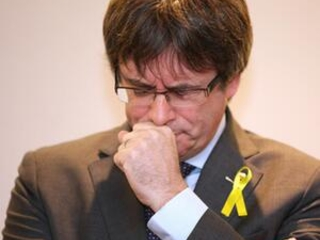 Catalan leader speaks for first time since warrants lifted