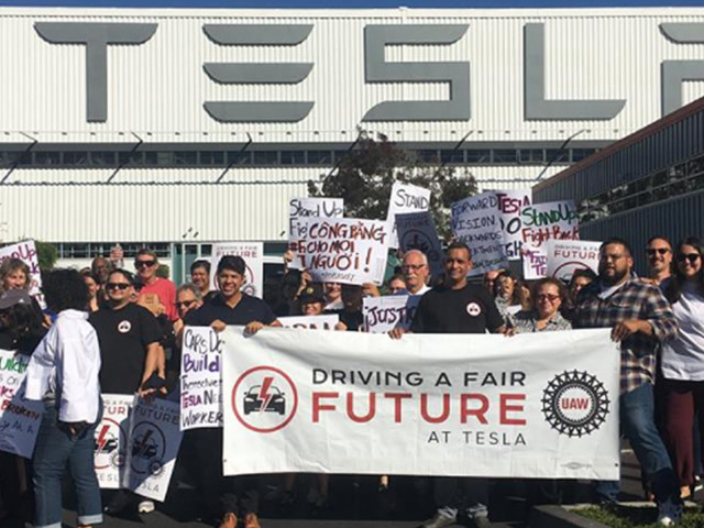 Tesla pro-union leaders march into the company's Fremont factory demanding some fired workers be rehired (TSLA)