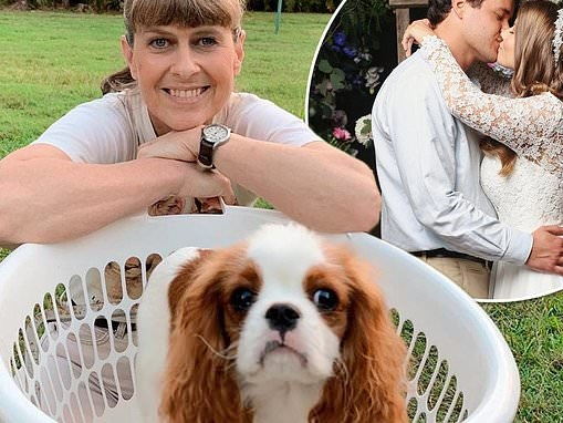 Terri Irwin hangs out the washing at Australia Zoo with adorable dog Piggy following Bindi's wedding