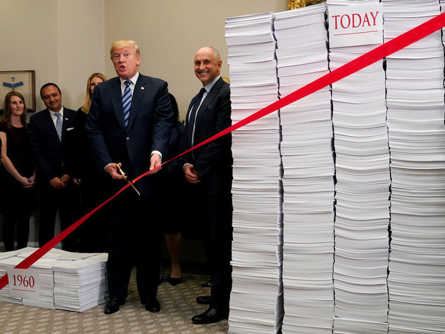 Donald Trump Fails To Learn From Sean Spicer's Gaffes And Employs Giant Stack Of Paper Prop