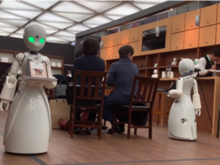 Japanese cafe lets paralysed workers control robots remotely