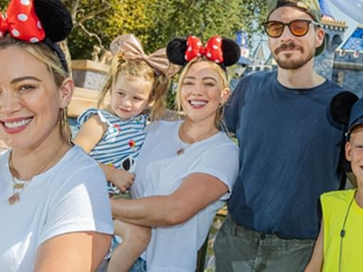 Hilary Duff rocks a pair of Minnie Mouse ears while enjoying a day at Disneyland with her family