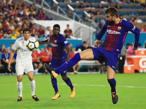 Pique lifts Barcelona as El Clasico lives up to hype