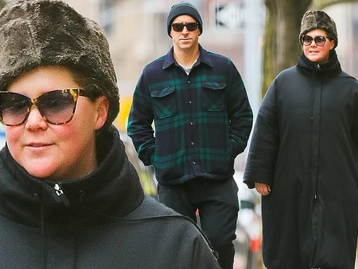 Amy Schumer bundles up out with husband Chris and jokes about 'watching the Oscars in sweatpants'
