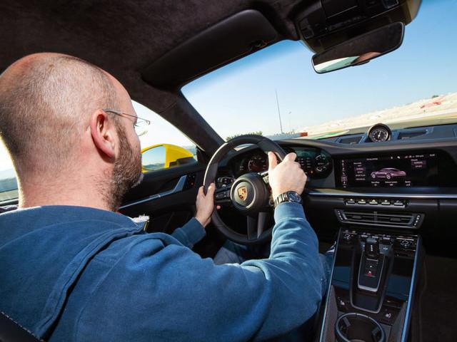 Is the Porsche 911's sports car throne still safe?