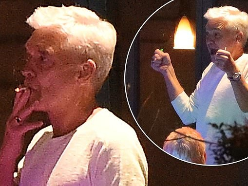 Phillip Schofield smokes cigarette and enjoys meal out with friends in Richmond
