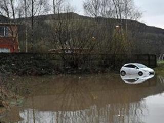 Storm closes Norwegian roads, floods Danish city
