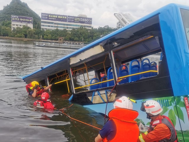 More than 20 dead after bus crashes into lake in China