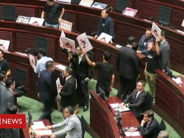 Hong Kong lawmakers disrupt Carrie Lam's address