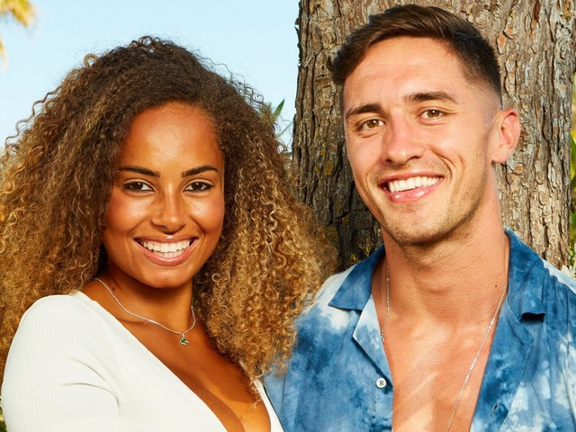 Love Island winners Amber and Greg share their first cosy bed selfie after becoming an official couple