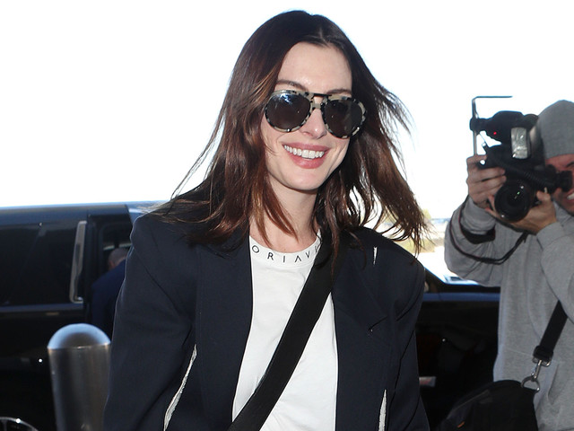Anne Hathaway Flies to New York for More 'Serenity' Press