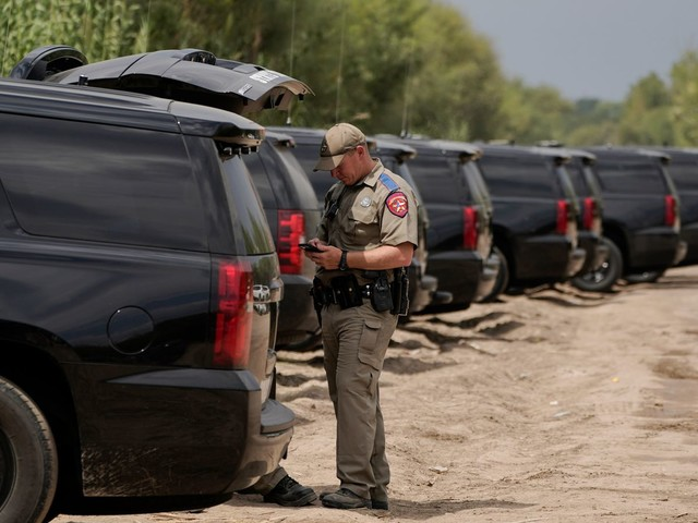 Vehicles form barrier at Texas border to deter migrants - as VP Harris criticises 'horrible' tactics