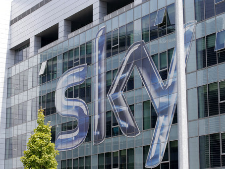 Comcast, Fox both raise bids as they reach for Sky