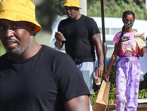 Diddy dons yellow bucket hat as he treats his three teenage daughters to shopping trip in Malibu