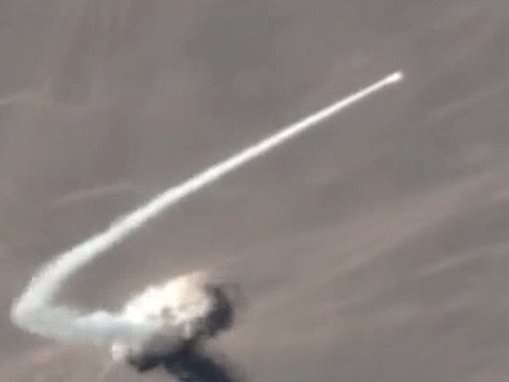 Rocket launch in the Gobi Desert is captured by a satellite orbiting above Earth