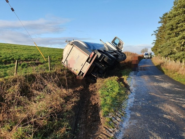 Road blocked after milk tanker crashes into ditch