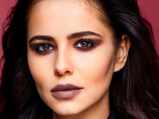 Cheryl unveils edgy post-baby look as she poses in unzipped black leather to advertise new lip kit range for charity