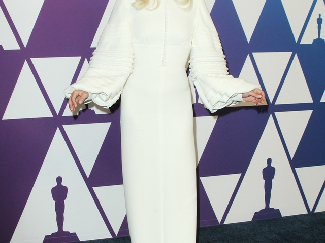 Lady Gaga wandered around the Oscar luncheon looking like Norma Desmond